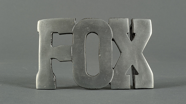 A belt-buckle bearing the name of Vicente Fox
