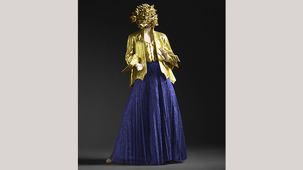 Ossie Clark's gold leather jacket and corset with purple lace skirt (1971)
