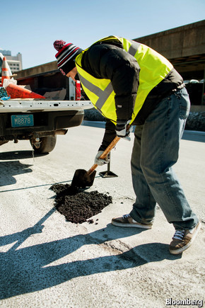 Worker filling pothole