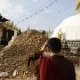 A monk reviews damage in Kathmandu
