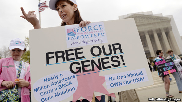 A protestor opposes gene patents outside the Supreme Court