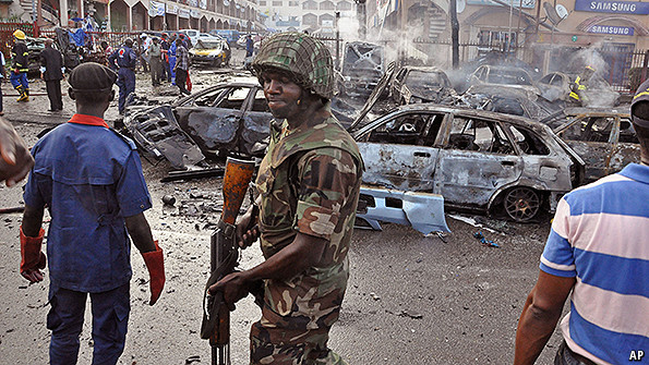 A Nigerian soldier at the scene of an explosion in Abuja, Nigeria