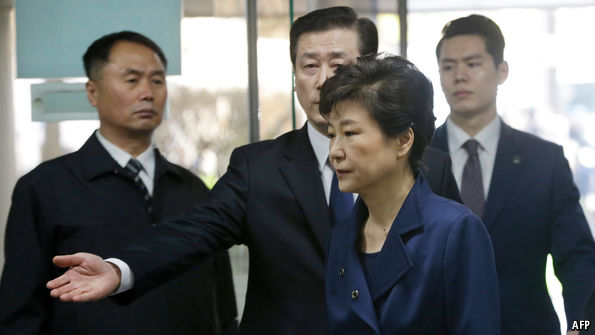 South Korea's president is arrested on charges of bribery and abuse of power