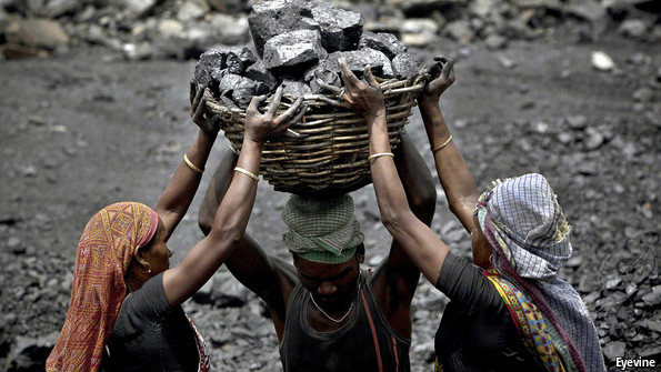 Three workers carrying coal in a basket
