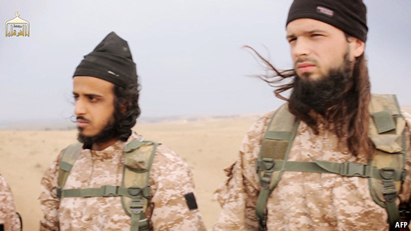 Believed to be Maxime Hauchard (at right), the French jihadi executioner