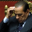 Berlusconi scrapes through