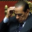 Berlusconi scrapes through