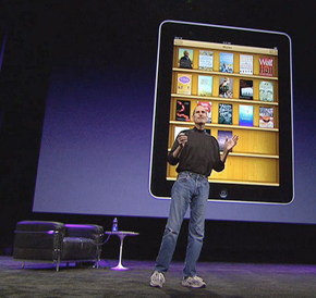 Steve Jobs in front of a digital bookshelf