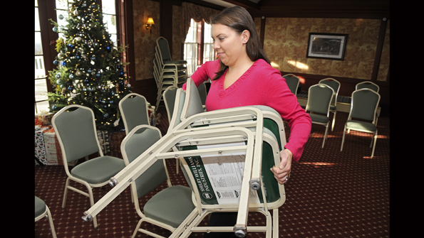 Sarah Crawford Stewart puts out the chairs