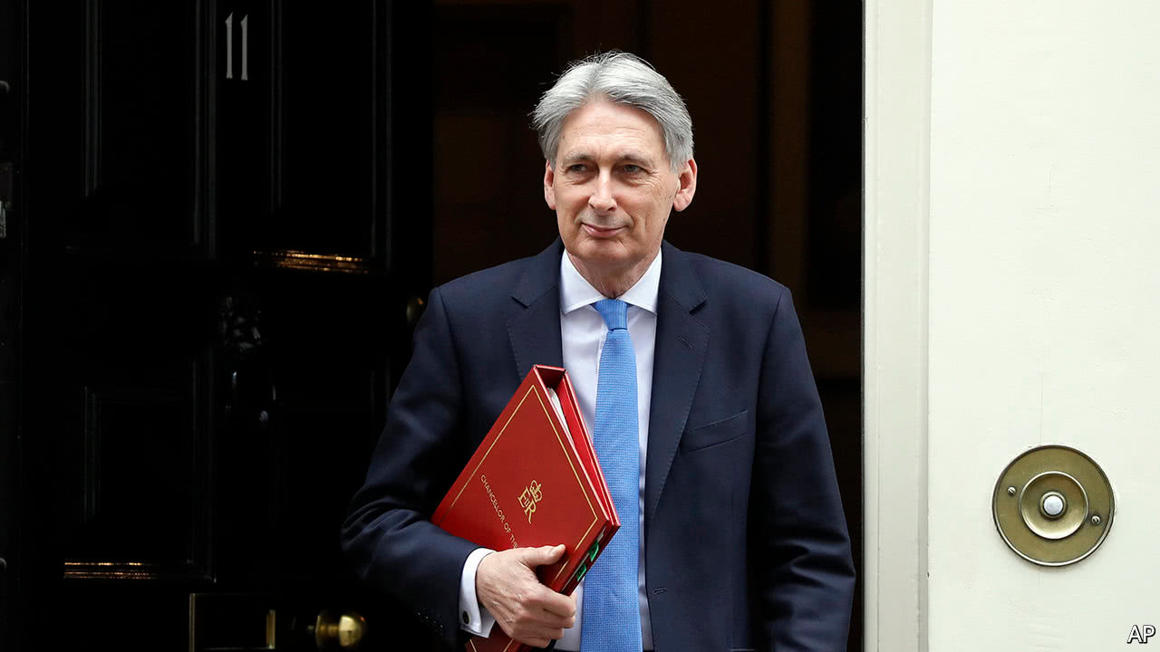 UK's sluggish economy to grow a bit more quickly: Hammond