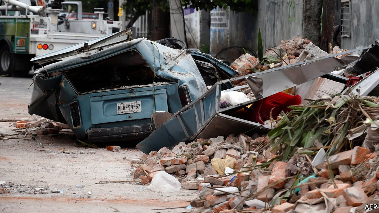 Strongest quake in a century hits Mexico, with at least 26 dead
