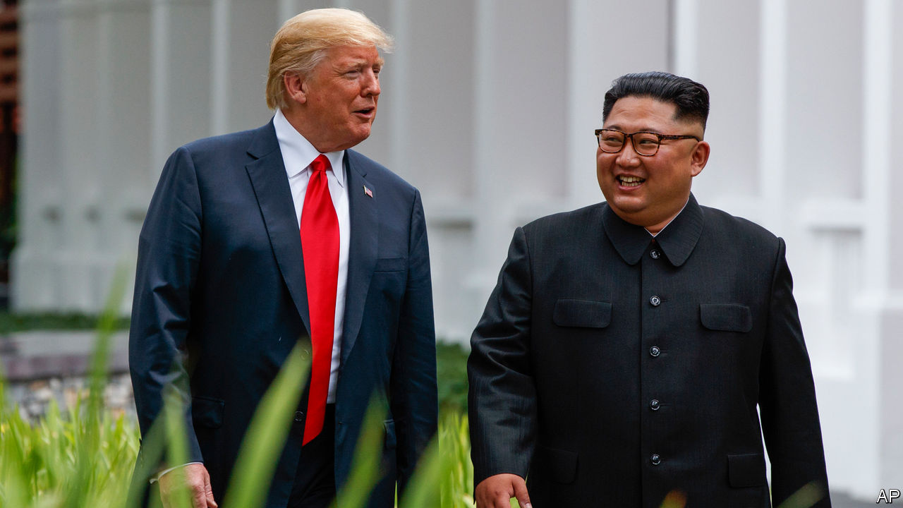 Donald Trump and Kim Jong Un share historic handshake at Sentosa