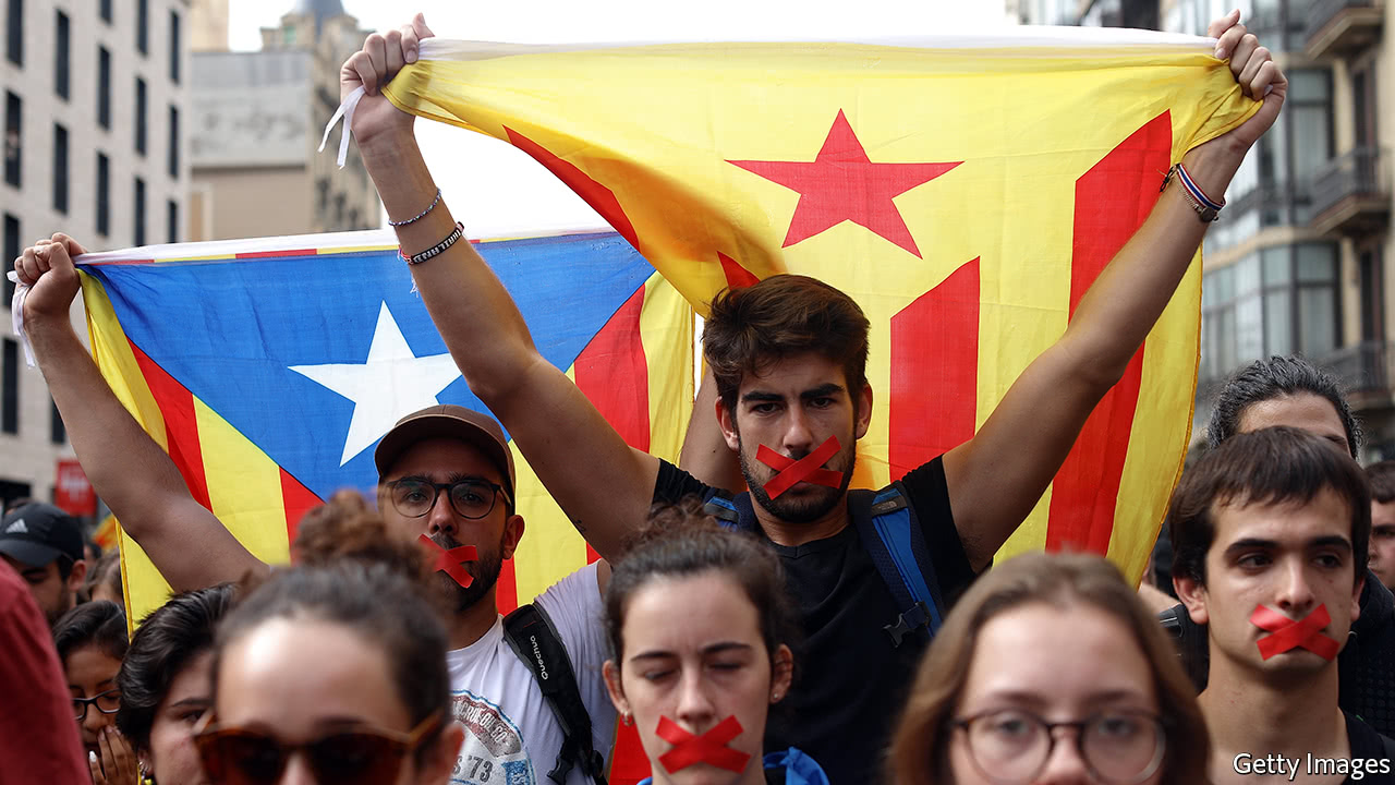 Hundreds of thousands march for unity in Spain after Catalan independence poll